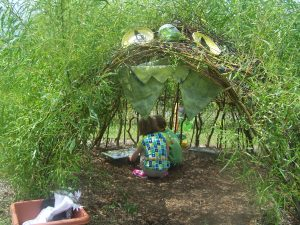 Designing for outdoor learning environments often means including small private spaces where children can huddle together