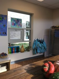 Entryway in a Reggio Emilia school with accessible windows.